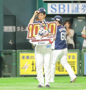 5回を終えて試合が成立し、公式戦通算1000試合出場を達成した秋山