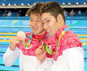 瀬戸大也(左)と萩野公介