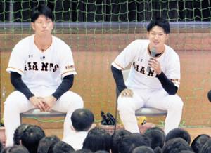子供の質問に笑顔で答える吉川尚(右)(左は大城)