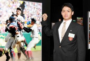 野球殿堂博物館を見学し、去年の夏に優勝した大阪桐蔭高の写真パネルにサインを入れる根尾(代表撮影)