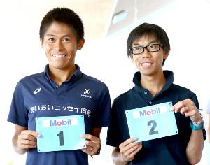 健闘を誓い合った川内優輝(左)と牛山純一さん