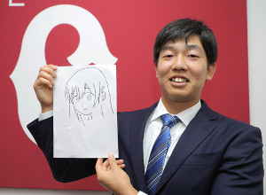 契約更改した畠世周。入籍したことを発表し、自身が書いた夫人の似顔絵を手に笑顔を見せた